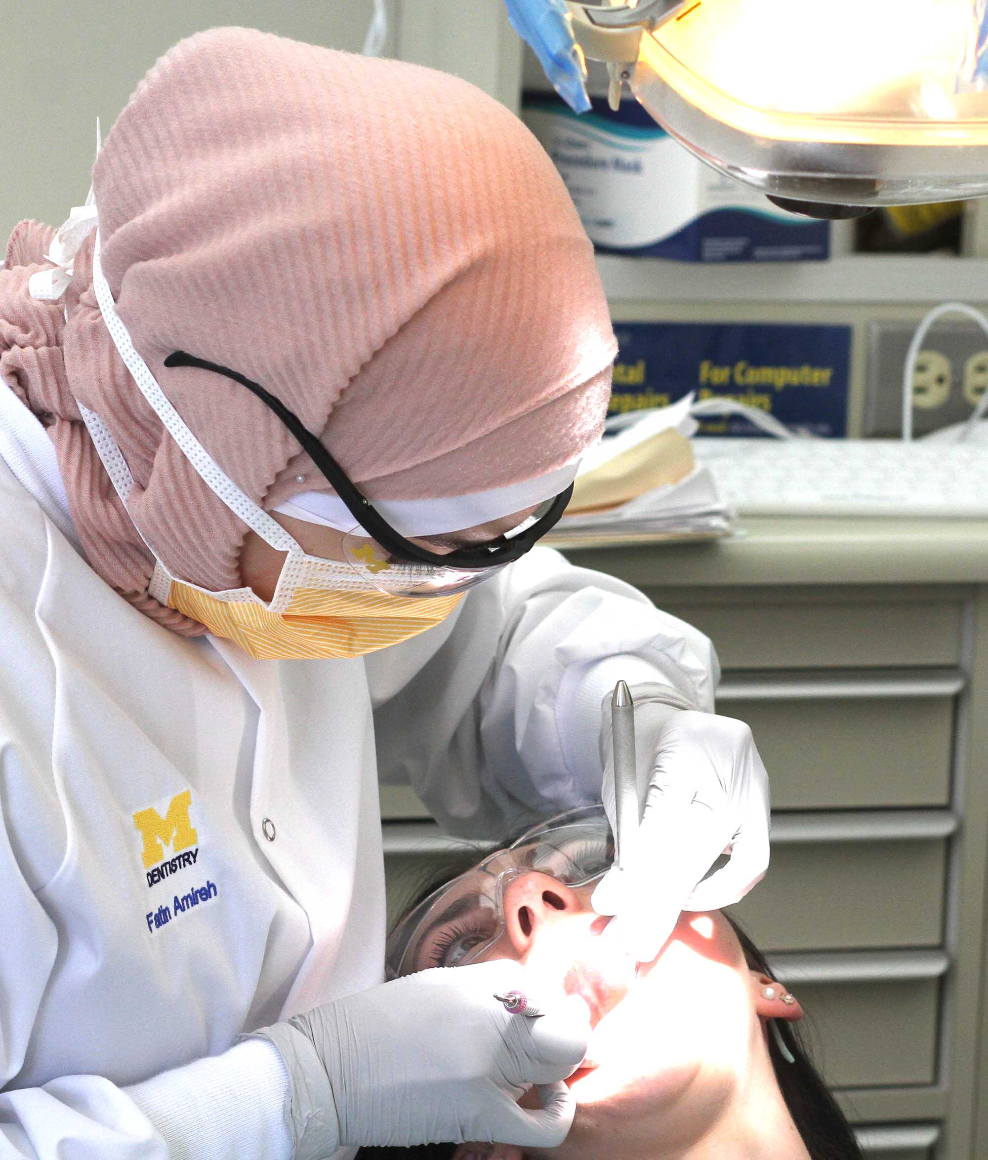 dental hygiene student working